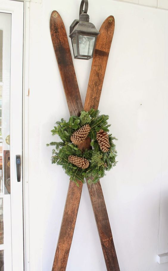 Vintage Skis - an evergreen wreath and wooden skis are an easy way to spruce up a winter porch - The Picket Fence Projects