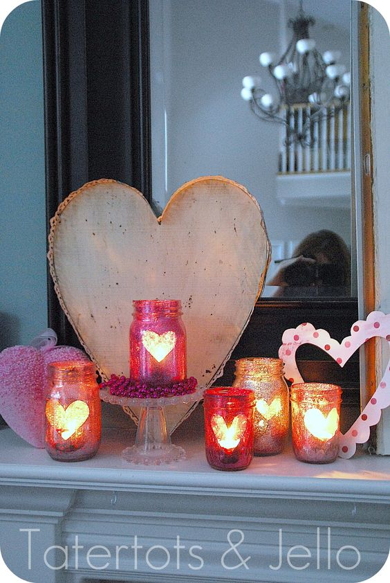 These glittery mason jars turned candle holders would make such charming centerpieces. They're inexpensive, easy to make, and you could customize them fully to your theme and color scheme. Instead of (or in addition to) hearts, consider your monograms or use them as table numbers.