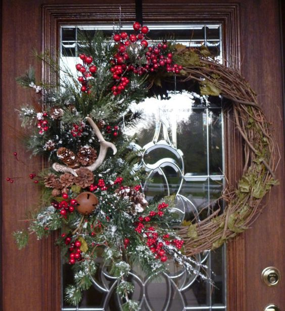 Grapevine wreath with christmas greenery and antler for Antler christmas wreath