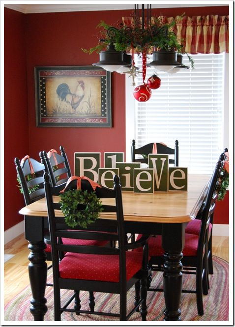 block letters! and the the wreaths on the backs of the chairs - I Love Christmas: Red Wall, Wall Color, Christmas Dining Room, Kitchen Table, Light Fixture, Christmas Table, Kitchen Christmas Decoration