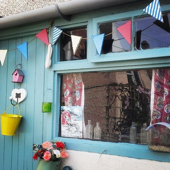 Just made some curtains for the shed from a couple of old Primark teatowels. #creative #hurryupsummer #gardenshed #bunting
