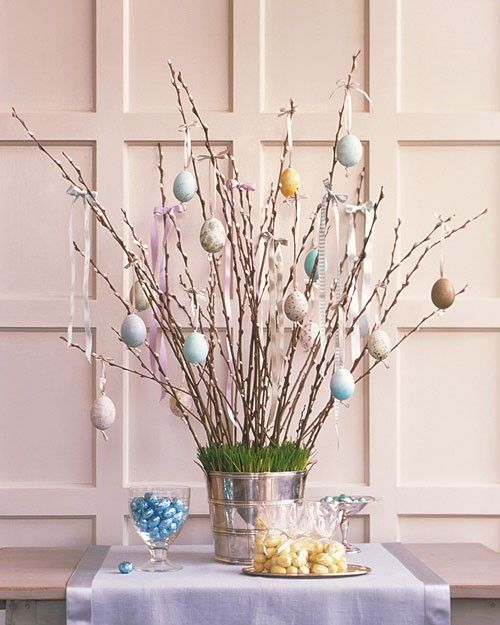 Create a tree out of pussy willows and dangle glittering Easter eggs from the branches.: