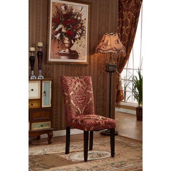 Add a bit of elegance to any room in your home with these exotic Parsons dining chairs. Each set includes two upholstered chairs covered in an ornate red-and-gold damask design. Featuring solid wood legs, these chairs have a comfortable high back.