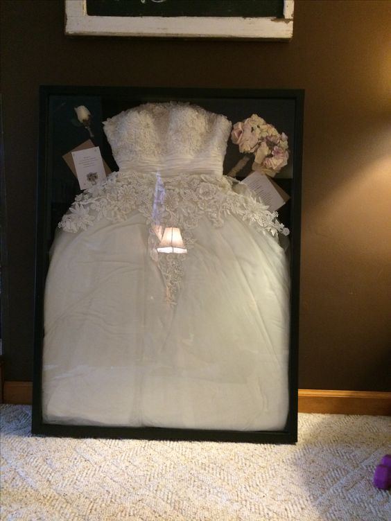 wedding dress in a shadow box get the largest one from hobby lobby i need to do this for my dress wedding ideas pinterest shadow box