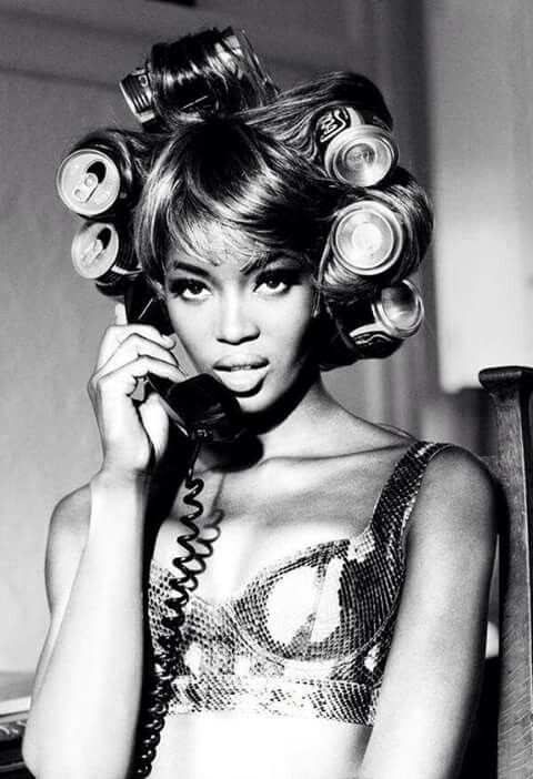 Naomi Campbell with Coke can hair rollers, 1991.