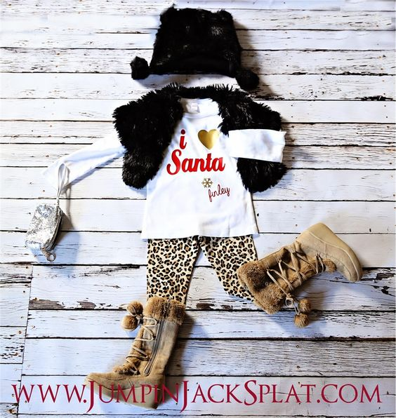 "Say Happy Holidays in these personalized tee's! Every child will love their very own personalized shirt or onesie to wear this season.Perfect for pictures with Santa, Holiday Celebrations & Classroom Parties!Options include:  ""Believe"" red BOY shirt or onesie""Believe"" white GIRLY shirt or onesie""I heart Santa"" GIRLY tee or onesie, heart can be made in silver, gold or greenTie with name red BOY tee or onesieIf choosing ""I Heart Santa"" Tee or onesie please ch..."