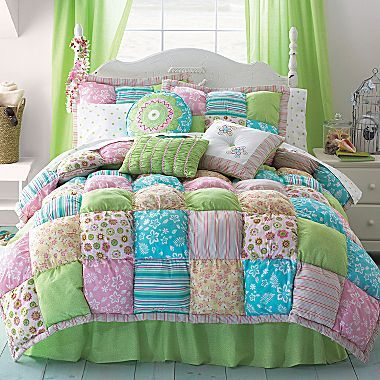 A new Akela Puff Comforter Set for our bed! A little girly for our bedroom remodel... sorry Dave :) but will be toned down with chocolate brown curtains and bedskirt!