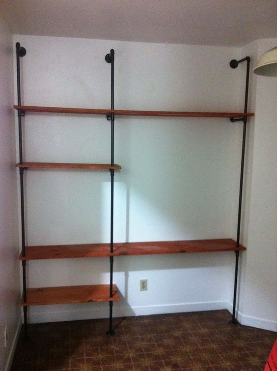 How to build a plumbing pipe shelving wall unit easy diy for Simple closet shelves