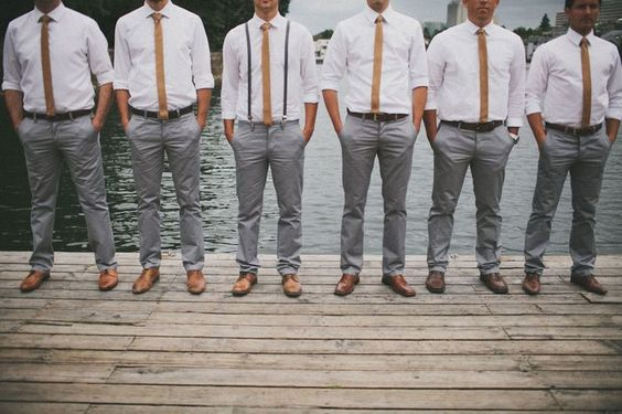 groomsmen in white shirts and grey trousers