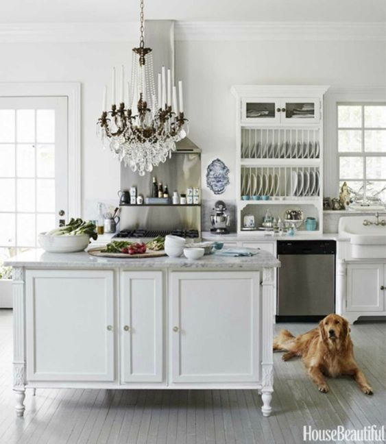 White kitchen with French Country decor. #kitchendesign #whitekitchen #kitchendecor #frenchcountry