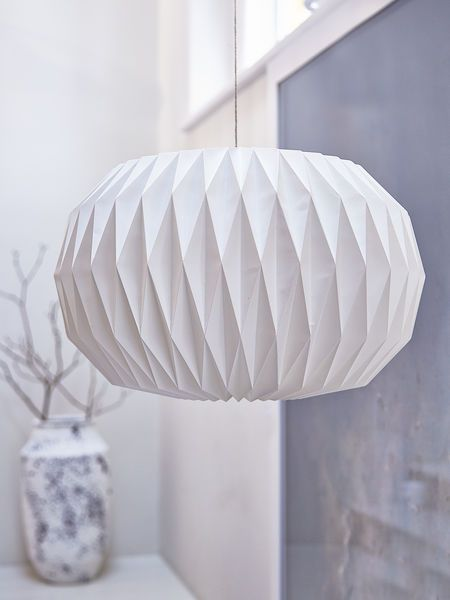 The gentle curves of this lampshade are made up of a many geometric folds, creating a wonderfully on-trend lighting design for the season ahead.