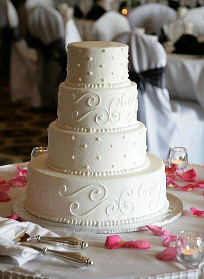 Safeway wedding cakes include beautifully decorated individual cakes and a small single or double layer cake to cut are also offered. The Safeway wedding cake prices listed above are the base prices. The more elaborate a special order cake is, the higher the price will be.