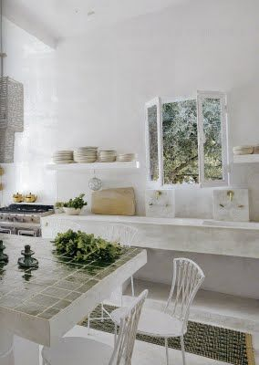 Rustic kitchen painted white in Maisons Cote' Sud - Photograph by Henri del Olmo. European Farmhouse and French Country Decorating Style Photos. #rusticdecor #kitchen #whitedecor #europeanfarmhouse