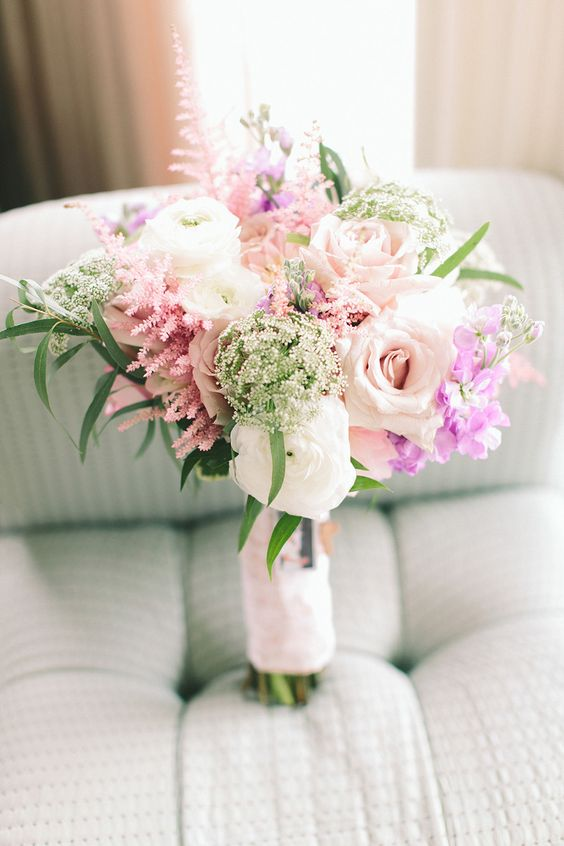 Spring or Summer Bouquet - by Betina's at Parkview | See the wedding on SMP:  http://www.StyleMePretty.com/tri-state-weddings/2014/03/06/summer-wedding-at-bonnet-island-estate/ Maggie Harkov Photography