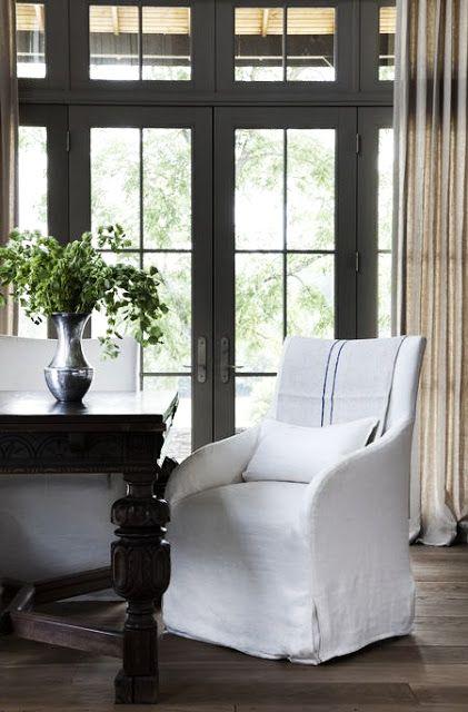 Linen slipcovered arm chair in modern farmhouse dining room. Rachel Halvorson Inspired Decorating Tips. #diningroom #modernfarmhouse #linen #slipcover #armchair