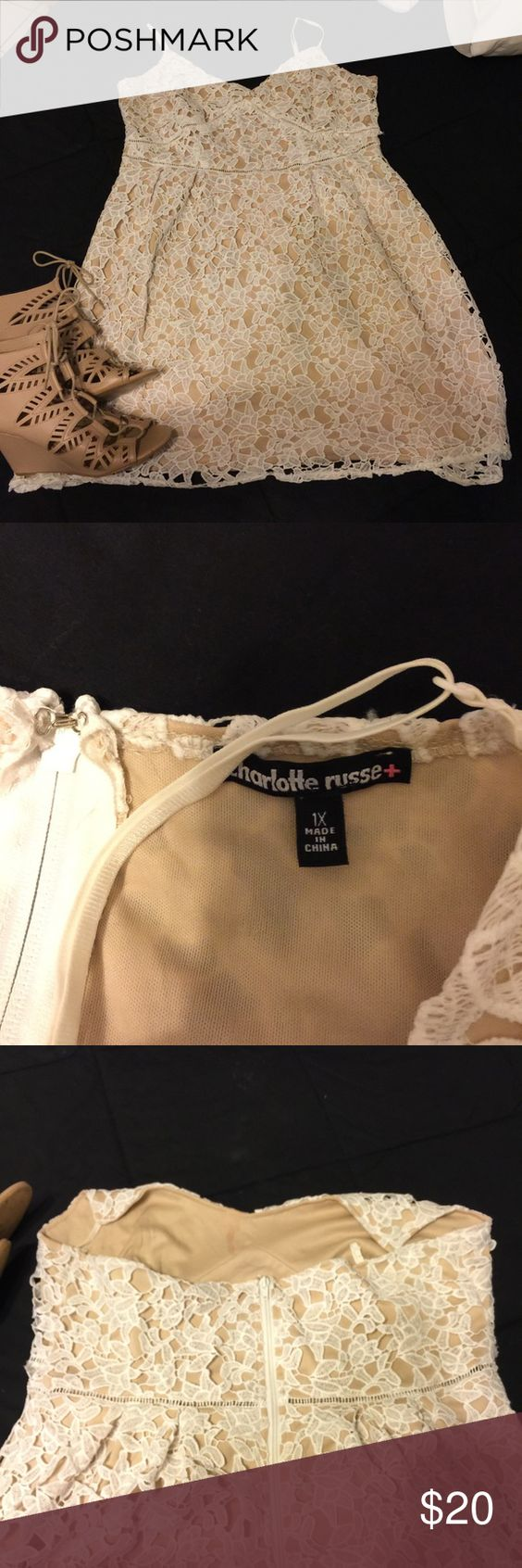 White and tan lace dress White over lay lace with stretchy tan underlay. Worn once for exactly 2 hours. Zipper up back. I'm a size 18/20 40C on top and it fits with a little room Charlotte Russe Dresses