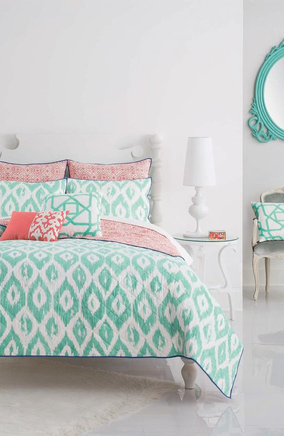 Loving the turquoise and coral bedding paired together for a bright and fun look in the bedroom.