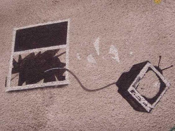 banksy-graffiti-street-art-tv-thrown-window