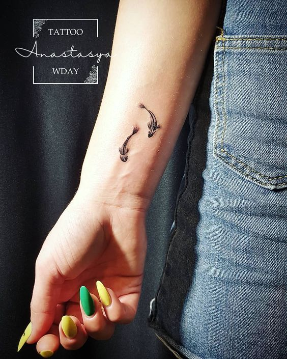 51 Stunning Pisces Tattoos That Capture The Uniqueness Of The Sign Pisces Tattoos Pisces Tattoo Designs Palm Tattoos