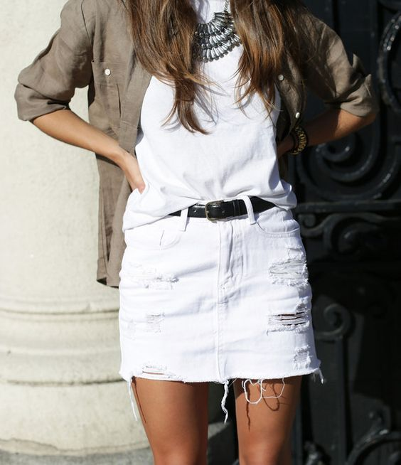Jessie Chanes is wearing a shirt from Old Ridel, T-shirt from ASOS and a skirt from Sheinside: