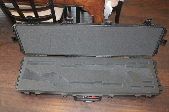 Pelican Storm iM330p case with custom cutouts for AR15, Marlin 1895 Rifle, scope and magazines.