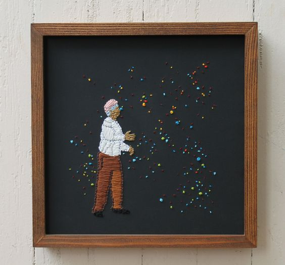 Framed embroidery by Mary Balda