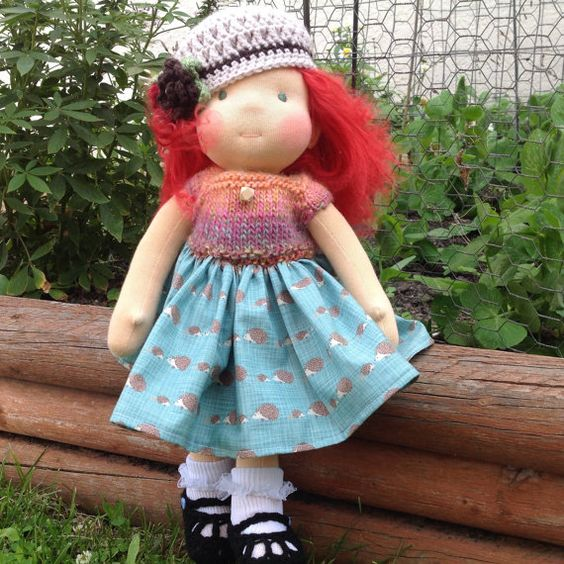 Waldorf Doll Dress  16-18 inch  Glee Anne is working in the garden. She has a dress on that has a hedgehog print. The bodice is knitted made