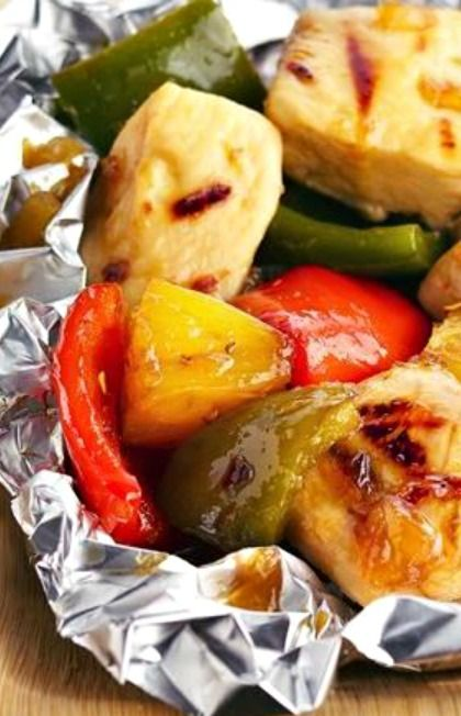 Grilled Pineapple-Chicken Kabob Packs Recipe ~ Bell peppers and other sweet-and-sour ingredients add incredible flavor to chicken when steamed together on the grill inside no-fuss foil pockets.