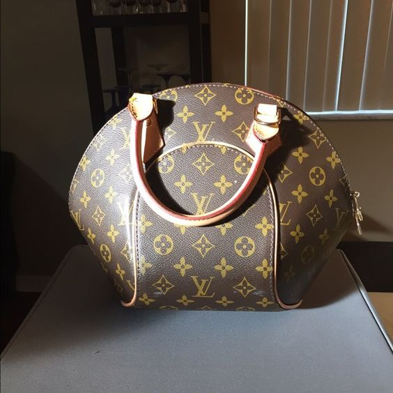 Pocketbook Brown and beige. Has a few pen marks inside. Outside excellent condition Bags