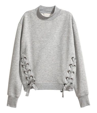 Gray melange. Long-sleeved sweatshirt with lacing at sides and ribbing at neckline, cuffs, and hem. Soft, brushed inside.