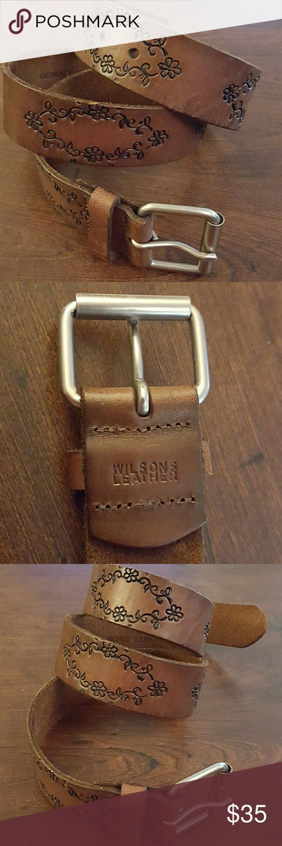 Genuine leather brown belt Excellent condition! Beautiful black design details on a genuine brown leather. 1.5 in wide. 37 in long with 1.5 in silver buckle. Medium. Wilsons Leather Accessories Belts
