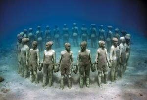 Photo by: Jason De Caires Taylor  Grenada underwater sculpture honoring those thrown overboard to their deaths during the Middle Passage.
