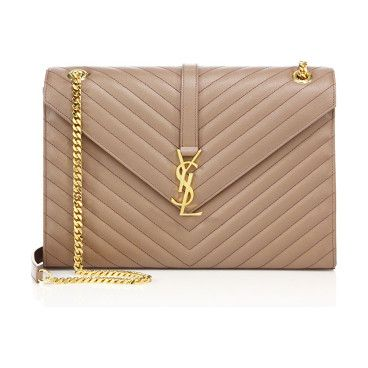 monogram large grained chain bag by Saint Laurent. Gracefully patterned chevron stitching creates the character of a sleek shoulder style in an envelope silhouette. Sho...: