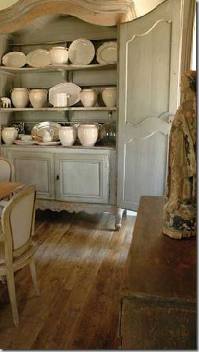 Gorgeous French Country dining room with painted cupboard with white French jars. Chateau Domingue. #frenchcountry #europeanfarmhouse #diningroom #biot