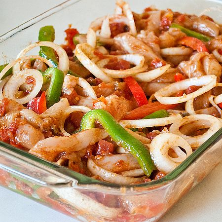 Oven-baked chicken fajitas. Everything is put into a 9x13 baking dish and baked for 25 minutes. Remove from oven and serve in warmed tortillas.