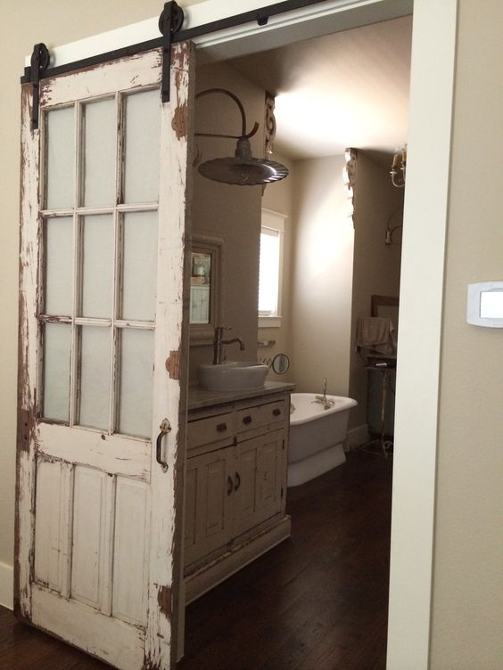 Old door re-purposed with Barn Door Sliding Fixture, for Bathroom Door (painted panes?):