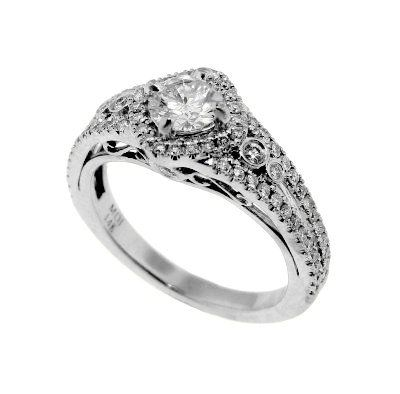 A 14k white gold and diam0nd ring.  The ring features a round brilliant cut diamond, 0.43 carat, H color, VS clarity.  The side diamonds total 0.20 carats, total weight.  Priced: $2,800.