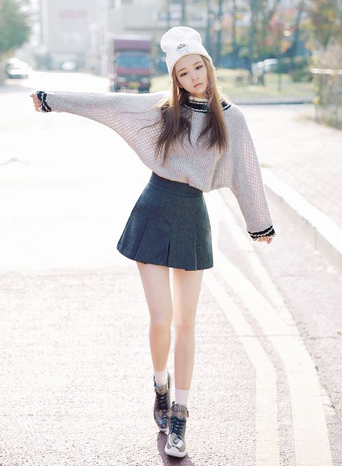 Not sure about shoes but kawaii oversized sweater tucked in a cute skirt❤