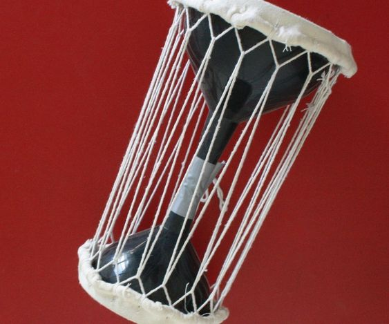 make a talking drum out of funnels homemade percussion and drums. Black Bedroom Furniture Sets. Home Design Ideas