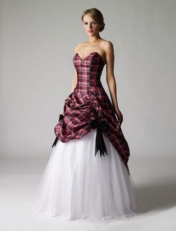 Ceilidh    £190    Colour:  Tartan & White    Size:  8 only   This striking gown is a one off, a mixture of tartan taffeta, white tulle over ivory satin and dresses with symmetrical black bows. The gown would be an amazing and unique wedding dress, prom dress or ball gown. The dress has a corset back detail to ensure a fabulous fit. This is the only dress of it's a kind, only one made and will never be repeated. UK size 8 only.