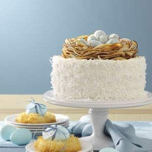 love the faux bird nest on top of this coconut cake...so cute for Easter!