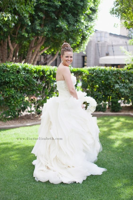 bride in diana vera wang gown