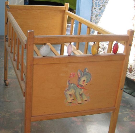 I remember thses back when babies stuck their heads through the bars the 70s pinterest Wooden baby doll furniture