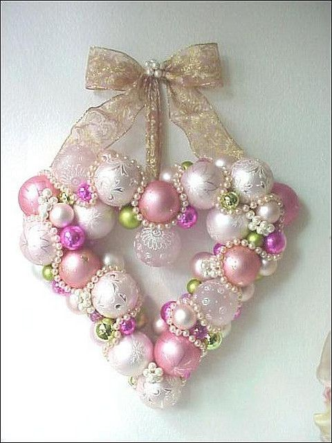 This gorgeous pink and white DIY Christmas wreath could also make a great wreath to use at Valentines