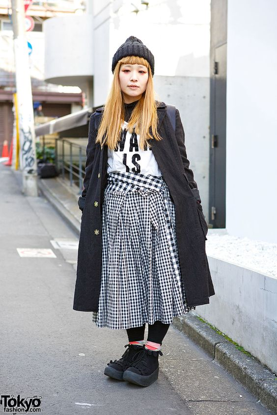 Kana's cool black look caught our eye on the street in Harajuku. We originally snapped these pics for Vogue.com during JFW. Kana is wearing a graphic t-shirt over a turtleneck, with a gingham ...