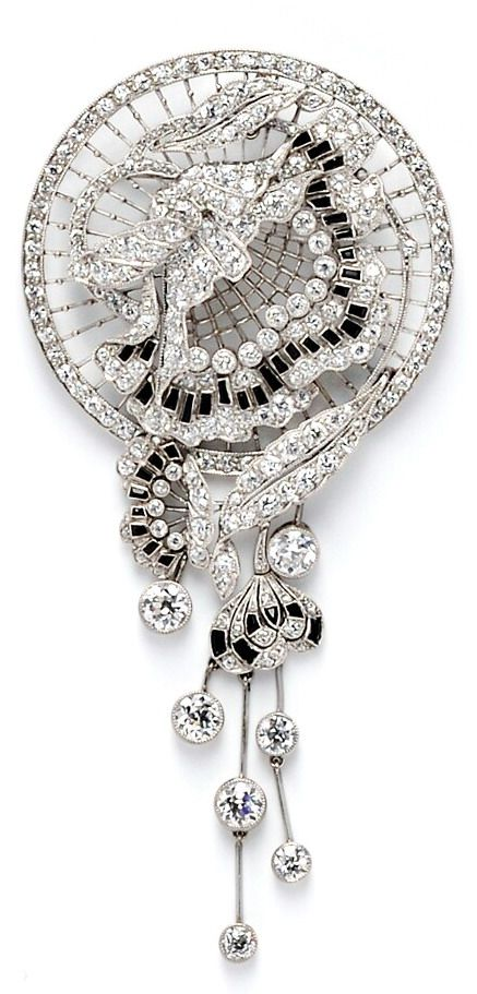 Art Deco Platinum and Diamond Brooch, designed as a flower on fine knife-edge bars, set throughout with old European-cut diamonds, calibre-cut onyx, and suspending bezel-set diamond drops, millegrain accents, approx. total diamond wt. 6.50 cts., lg. 3 1/2 in.