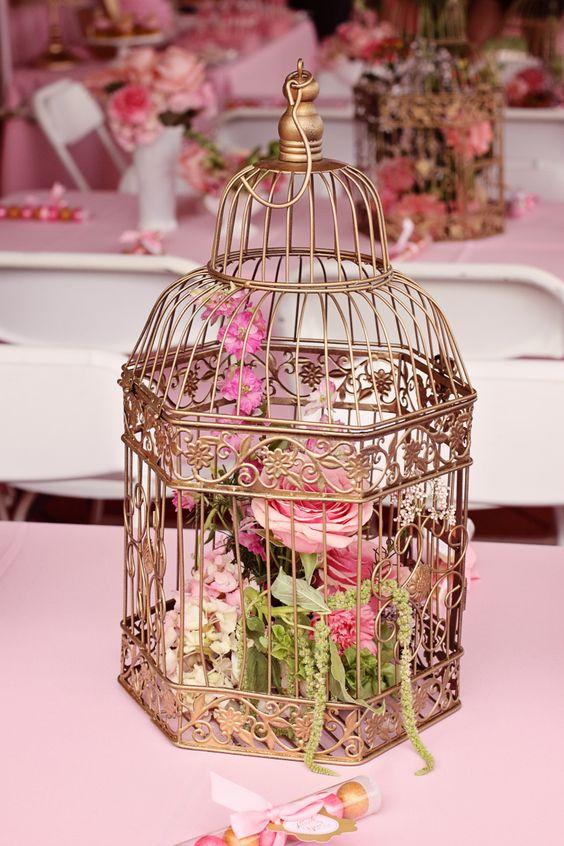 Flower arrangements in bird cage my baby shower pink