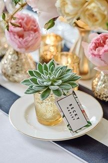 For wedding favours with a difference, try a flower or a plant in a votive on the tables (BridesMagazine.co.uk)