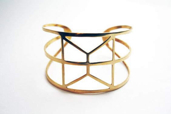 d e s c r i p t i o n The Astra cuff is a brass bracelet with geometric cutouts. This cuff is now cut from thicker brass for added strength, but is