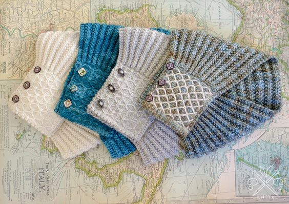 Left to right: Shibui Merino Worsted in Ivory and Dragonfly (sadly discontinued), Cascade 220 in Silver Gray, Madelinetosh Tosh Merino in Cove (MC) and Paper (CC). Buttons on blue sample are abalone shell beads, all others are from Textile Garden.